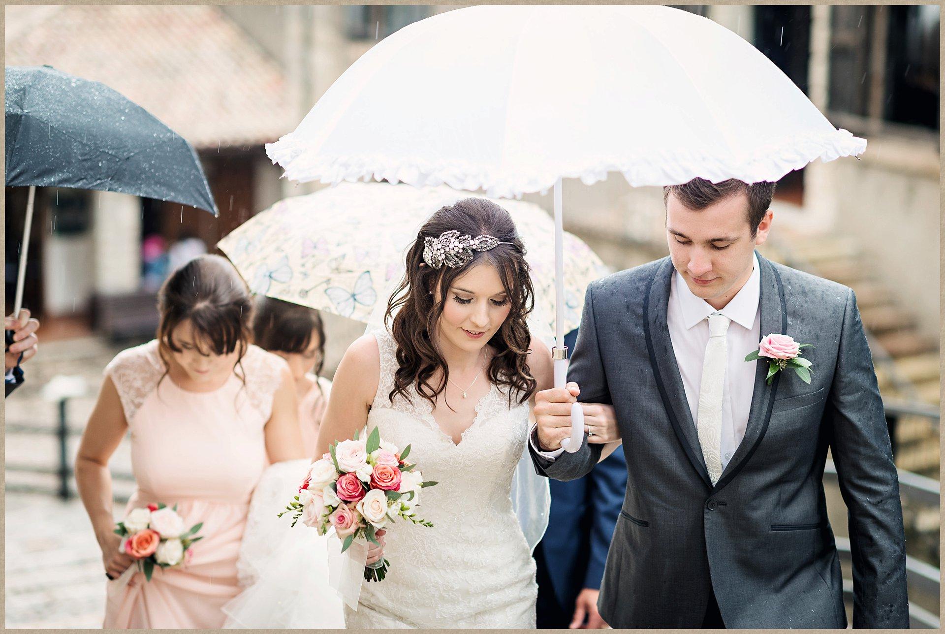 Bride walks the steps up to Malcesine Castle for her wedding