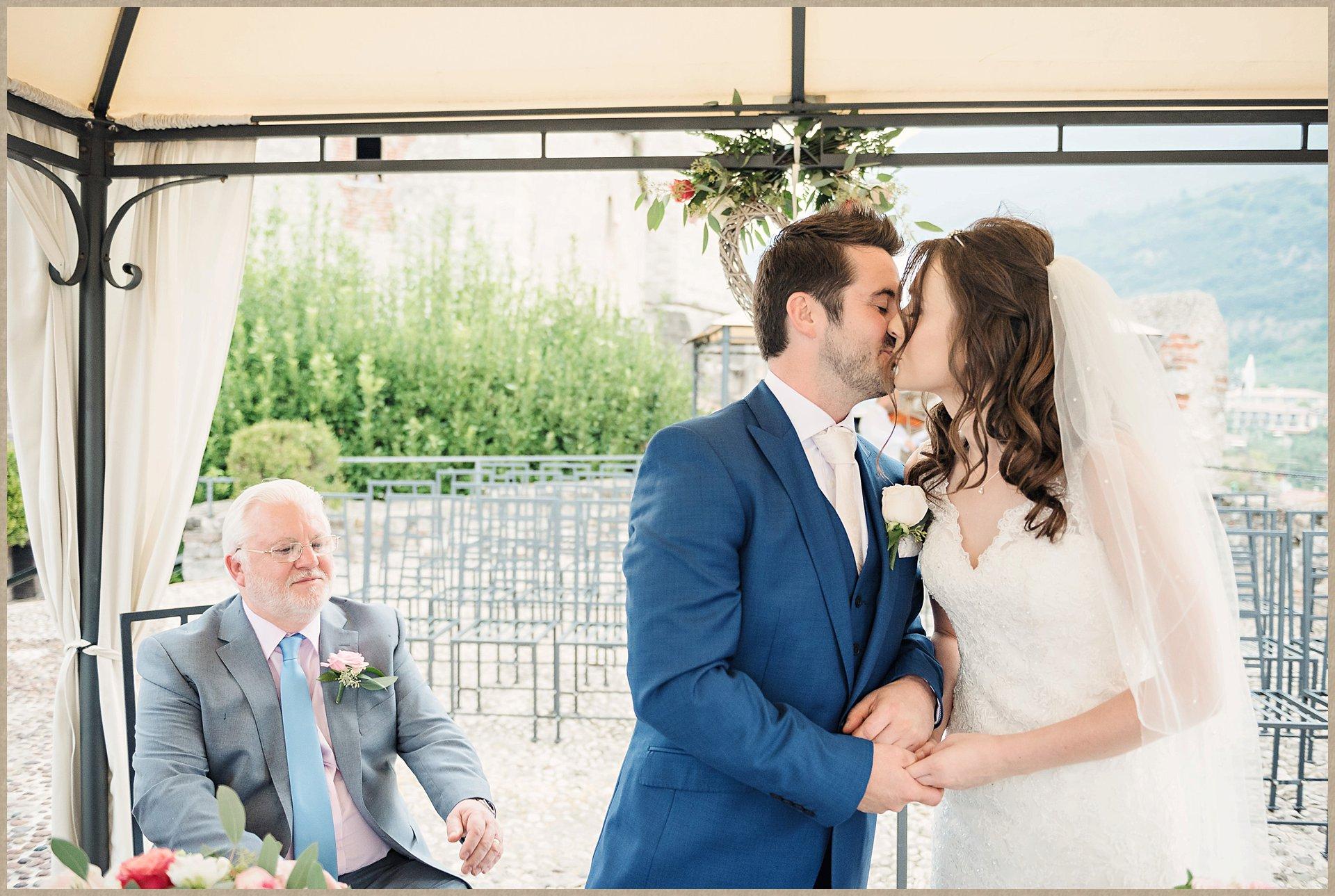 Bride and groom kiss - Malcesine Castle Wedding